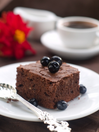 Chocolate brownie with coffee, selective focus photo