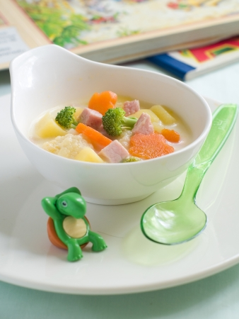 kids eating healthy: A bowl of soup for baby. Shot for a story on homemade, organic, healthy baby foods.  Stock Photo