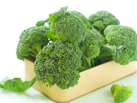 Fresh green broccoli on light background, selective focus Stock Photo