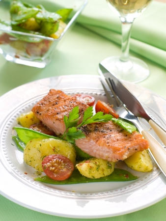 grilled salmon with potato, pea and tomato, selective focus photo