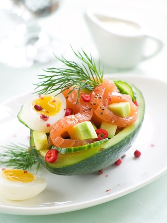 Salmon, avocado and egg salad in avocado, selective focus Stock Photo - 16589060