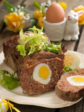 Meatloaf with egg for easter dinner, selective focus Stock Photo - 17331116