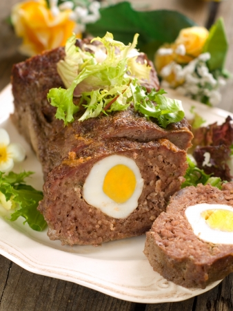 Meatloaf with egg for easter dinner, selective focus Stock Photo - 17331120