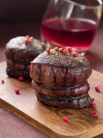 Filet mignon with red pepper and wine sauce, selective focus photo