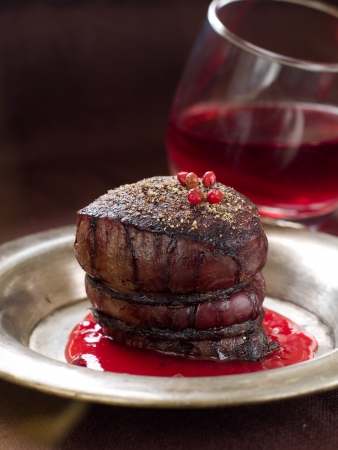 Filet mignon with red pepper and wine sauce, selective focus