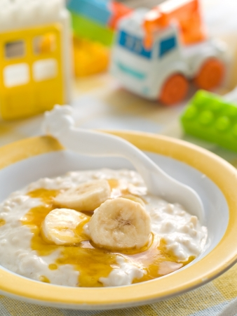 A bowl of porridge for baby. Shot for a story on homemade, organic, healthy baby foods.  photo