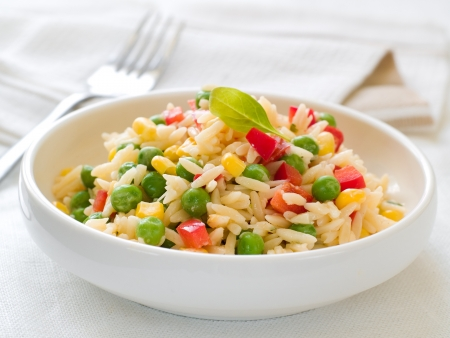 boiled: Bowl of pasta (orzo) or rice with vegetables, selective focus Stock Photo