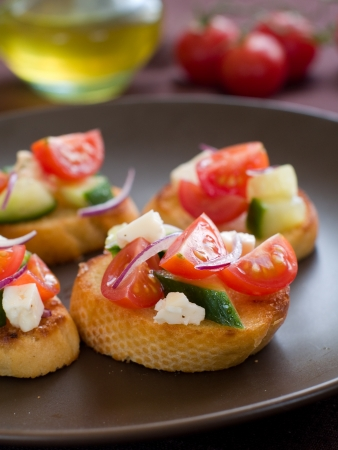 Bruschetta with juicy vegetables, selective focus photo