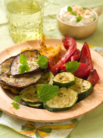 Grilled vegetables with thyme and mint on the wooden plate, selective focus  Stock Photo