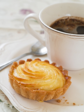 ricotta cheese: Ricotta cheese tart with coffee, selective focus Stock Photo