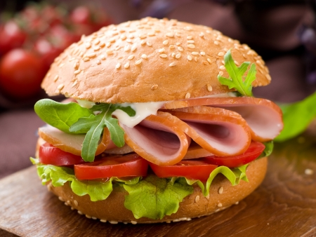 Hamburger with ham, tomato and lettuce, selective focus  photo
