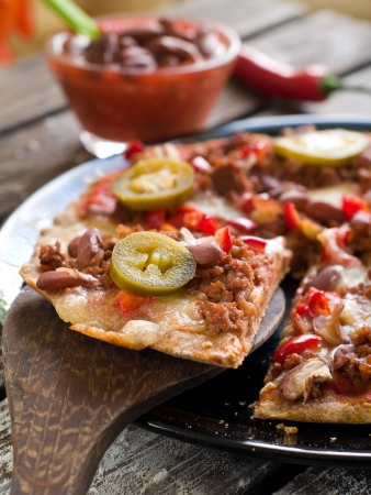 baked beans: Mexican pizza with minced bean, bean and jalapeno, selective focus
