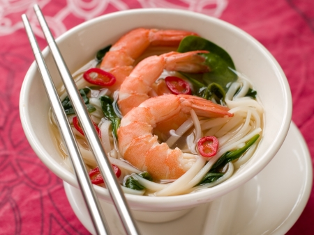 Asian noodles soup with shrimp and chilli, selective focus photo