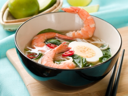 Asian noodles soup with shrimp, egg and chilli, selective focus photo