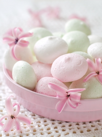 Meringue cookies in bowl with flower, selective focus Stock Photo
