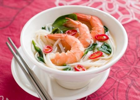 Asian noodles soup with shrimp and chilli, selective focus photo