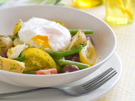 Vegetable salad with poached egg, selective focus Stock Photo - 19291095