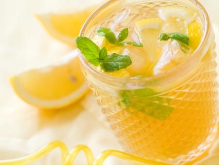 lemon juice: Cold fresh lemonade drink close up, selective focus Stock Photo