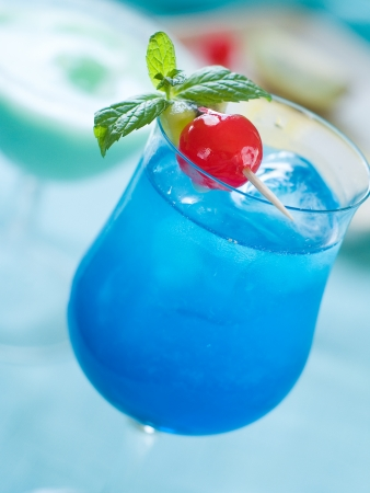 Blue cocktail with ice, selective focus photo