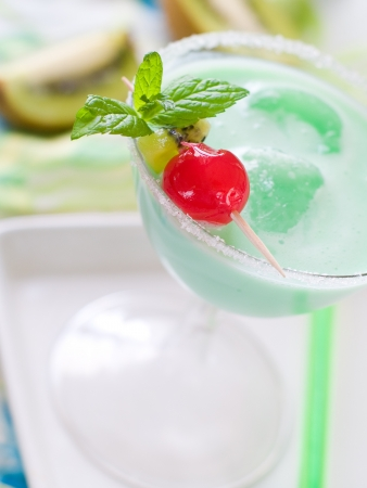 Green cocktail with ice, selective focus photo