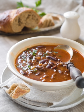 A bowl of homemade chili bean soup with meat, selective focus