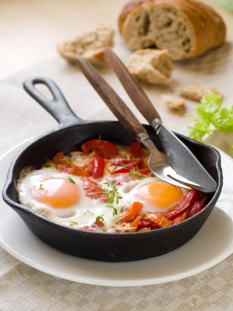 Fried egg with tomato and pepper (shakshuka) for brekafast, selective focus