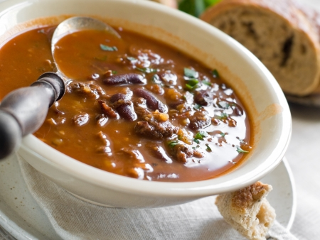 A bowl of homemade chili bean soup with meat, selective focus photo