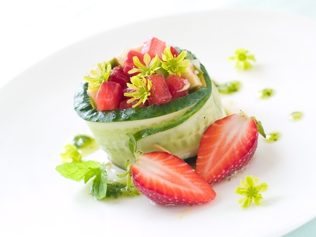 Strawberry and avocado salad in cucumber ring, selective focus photo