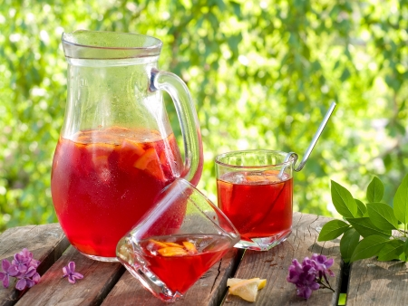 Refreshing fruit lemonade or Sangria in pitcher and glasses, selective focus  Stockfoto