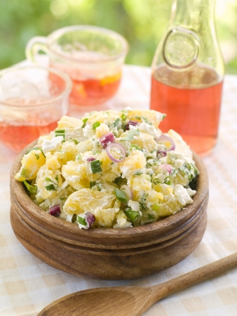 salad fork: Potato salad with mayonnaise and spring onion, selective focus
