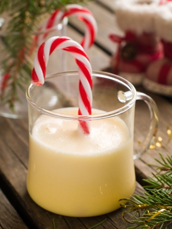 candy stick: Eggnog with candy stick at christmas time, selective focus