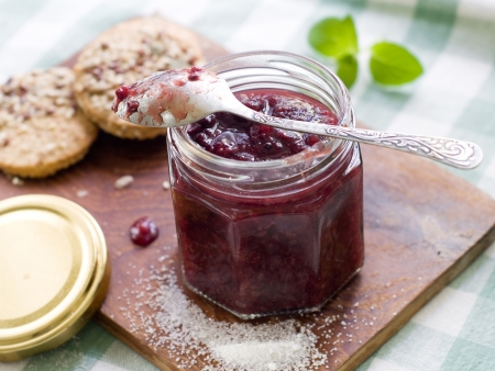 Berry jam in glass jar, selective focus photo