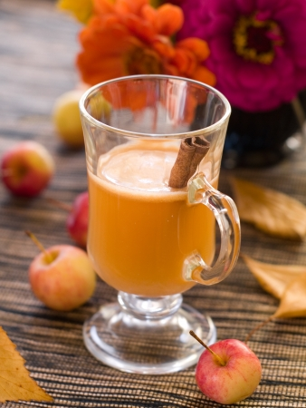 Fresh apple hot drink with cinnamon, selective focus