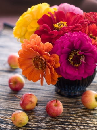 Composition with an autumn apples and flowers, selective focus  photo