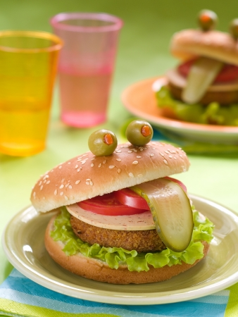 Delicious hamburger like a frog for kids party, selective focus photo