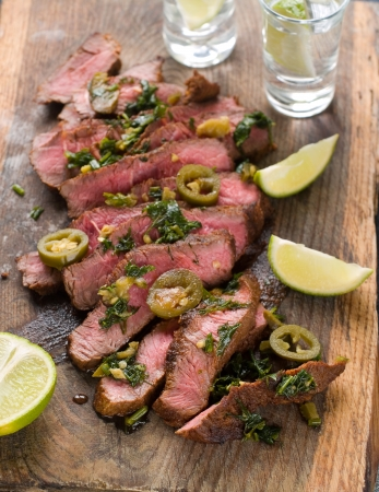 jalapeno pepper: Mexican steak with jalapeno pepper and tequila, selective focus Stock Photo