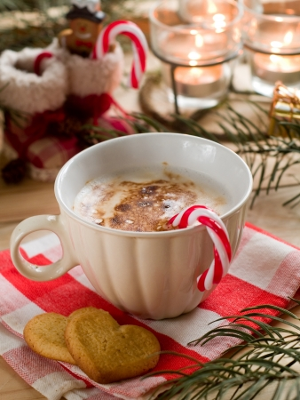 candy stick: Hot cocoa drink with candy stick, selective focus Stock Photo