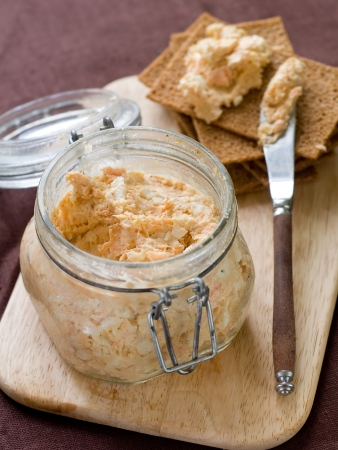 Fish, soft cheese and egg pate in glass jar, selective focus