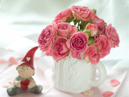 Pink roses in white cup for celebration photo
