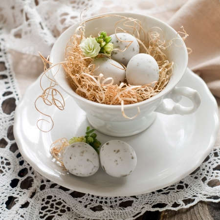 Chocolate Easter eggs in white cup photo