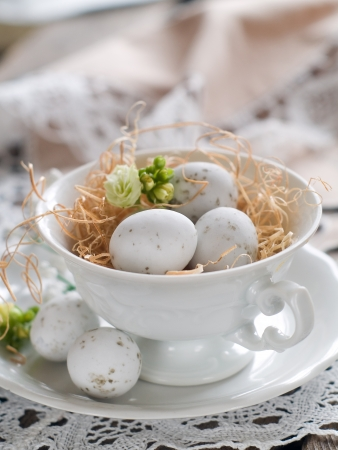 Chocolate Easter eggs in white cup, selective focus photo