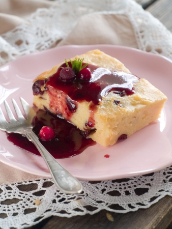 Cottage cheese cake with berry sauce, vintage style, selective focus photo
