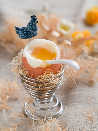 Soft boiled egg with easter decoration, selective focus Stock Photo