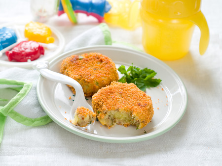 Fish and potato pancake or croquette. Shot for a story on homemade, organic, healthy baby foods.  photo