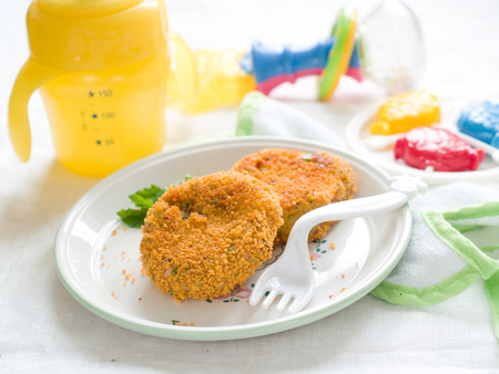 Fish and potato pancake or croquette photo