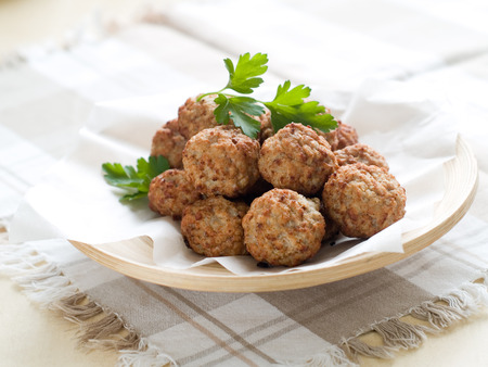 Minced meat ball in bowl, selective focus  Stockfoto