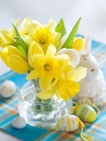 Spring flowers, bunny and easter eggs for holiday photo