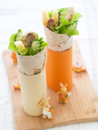 Wrap with grilled chicken and vegetables for children party, selective focus  photo