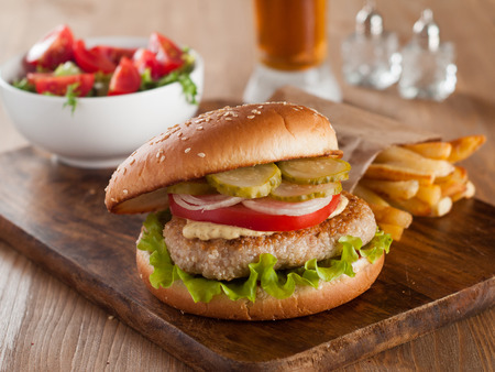 Delicious burger with vegetable and sauce,selective focus  photo