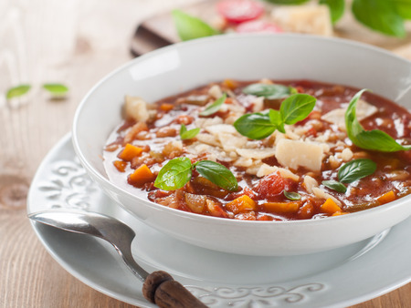 minestrone: Minestrone soup with cheese and basil, selective focus Stock Photo